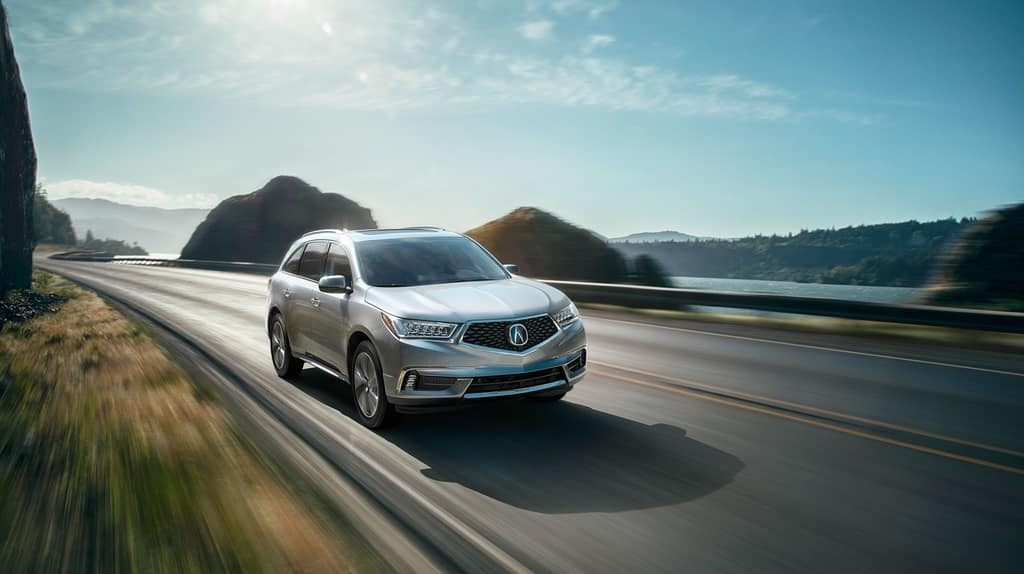 Acura MDX Driving on Mountain Road
