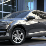 Silver 2020 Acura RDX In front of building
