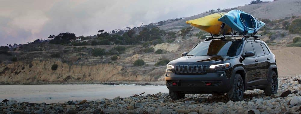 2019 Jeep Cherokee with Kayaks by Lake