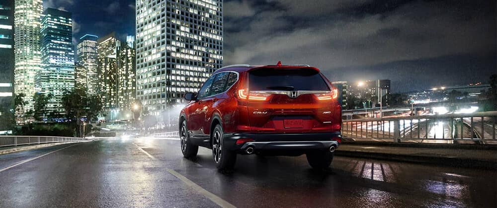 2018 Honda CR-V on city road at night