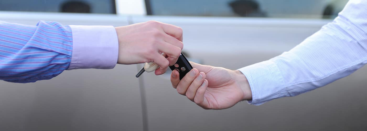 hands the keys to the car
