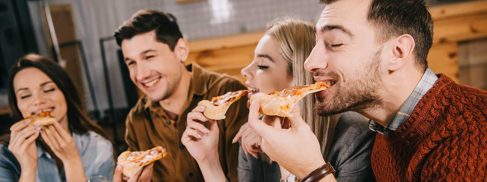 friends enjoying pizza