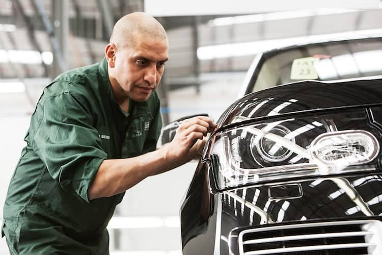 Land Rover Service Technician Performing Body Inspection