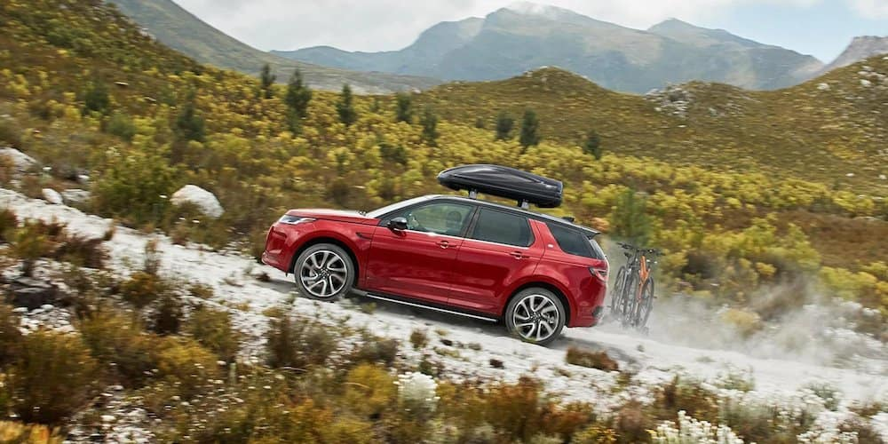 Red 2020 Land Rover Discovery Sport on Hill