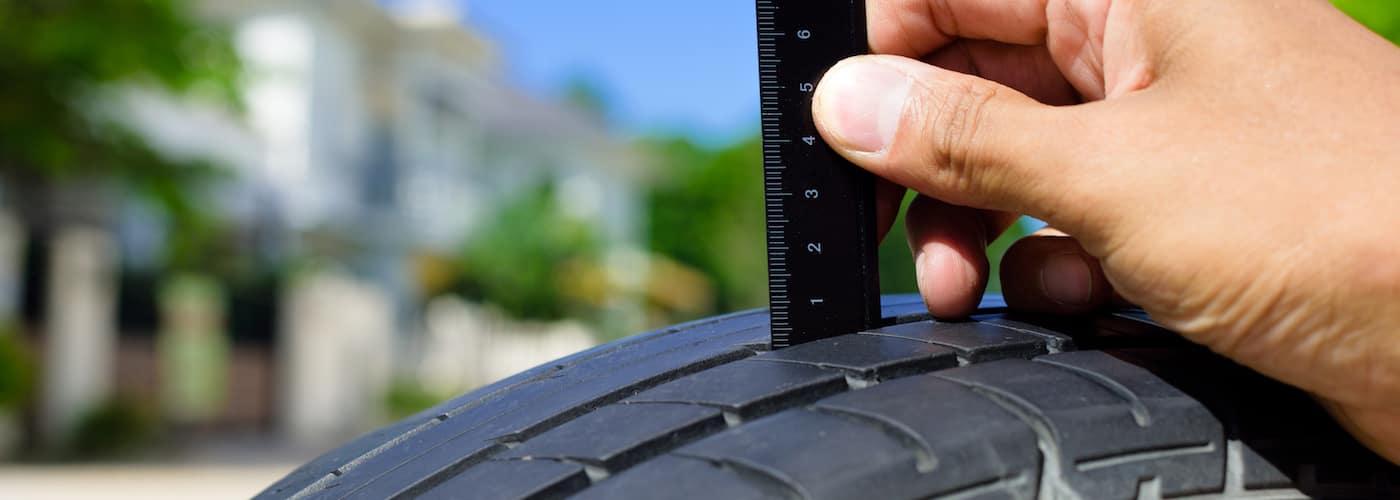Man Checking Tire Tread