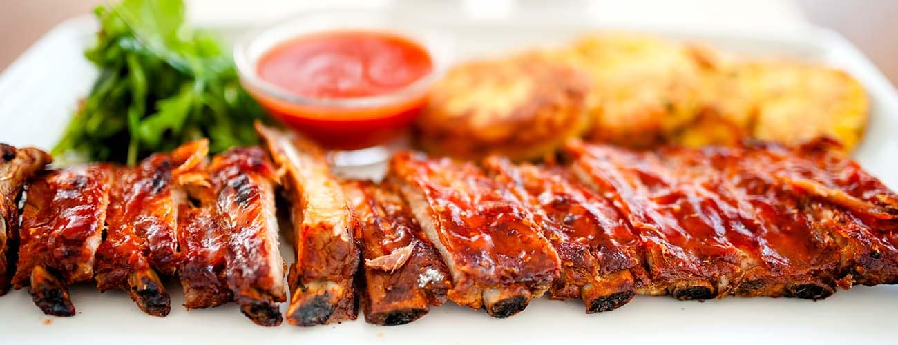 main dish - pork ribs and barbeque sauce with parsley and bread