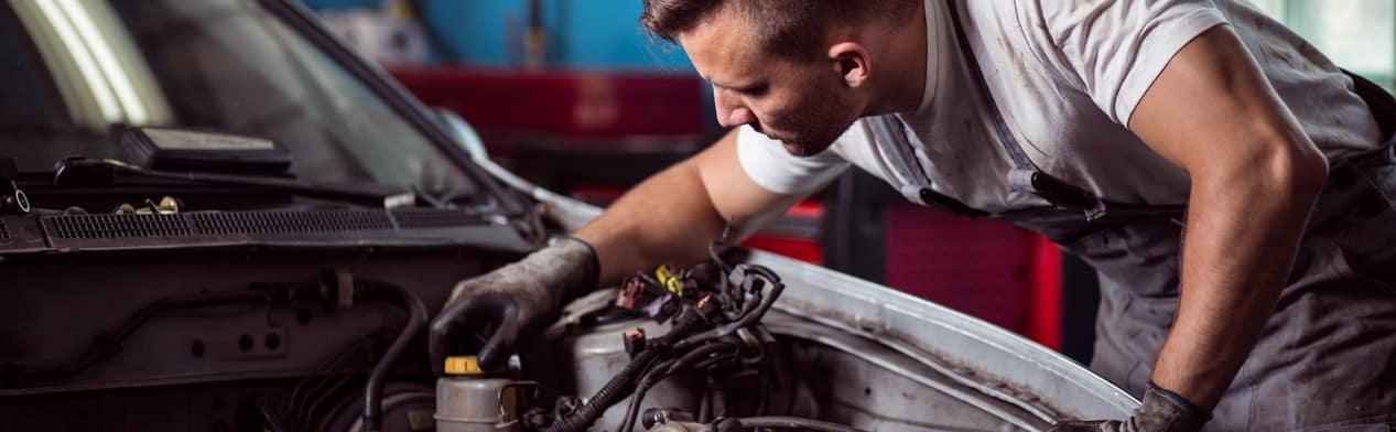 Mechanic Checking Engine & Oil