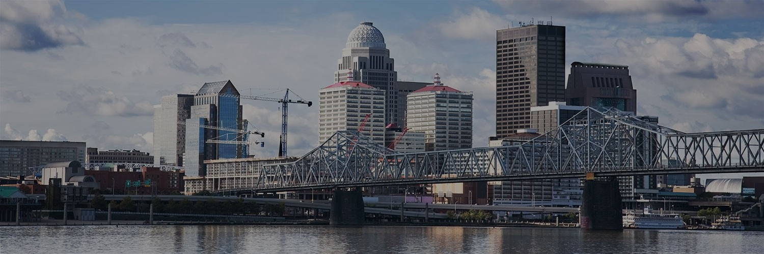 A view of a bridge in Louisville with the cityline in the back