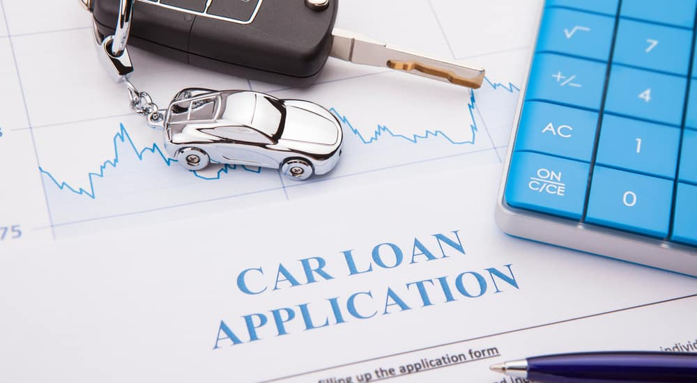 Car Loan application form, keys and car keychain