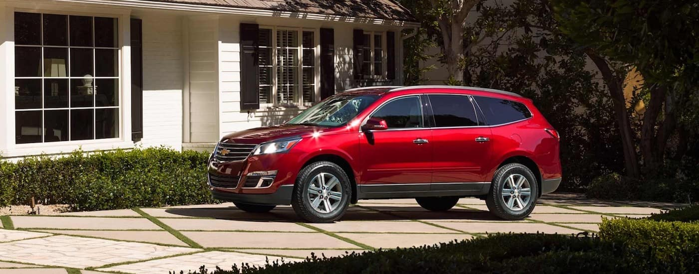 A red 2017 Chevy Traverse purchases from an online car dealer outside a Indianapolis home