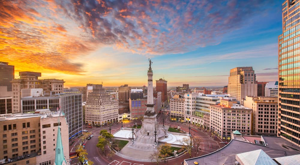 The Soldiers' and Sailors' Monument in Indianapolis against a vibrant sunset