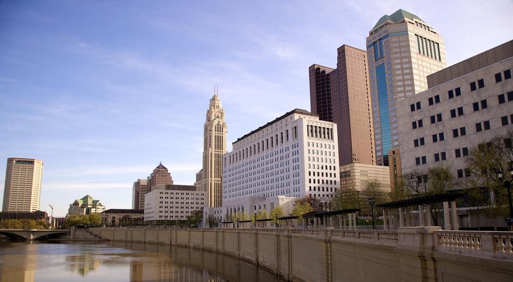 The Columbus skyline on a sunny day against a blue sky