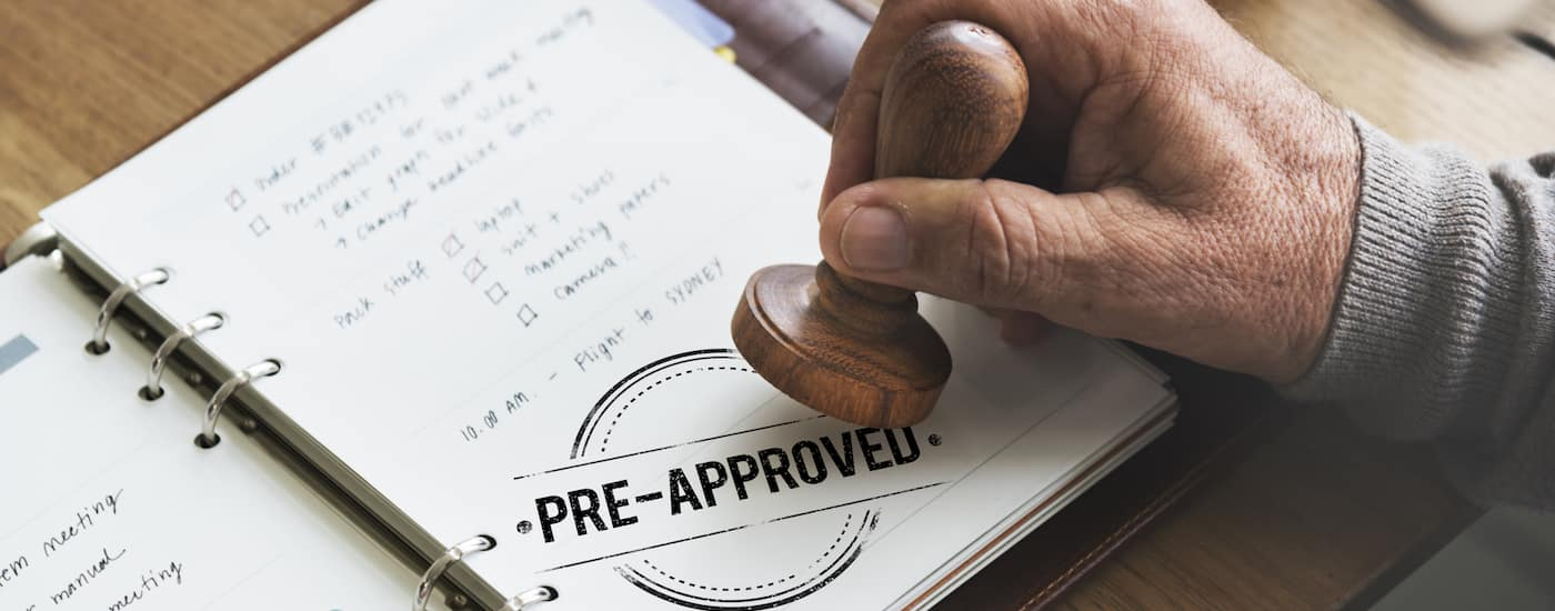 A approval stamp on car loan paperwork
