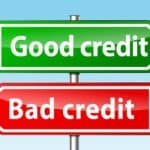 Signs depicting making the choice between bad credit and good credit