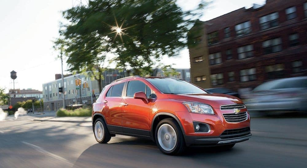 A bright orange used Chevy Trax cruises a local Cincinnati street on a road trip to Columbus Ohio