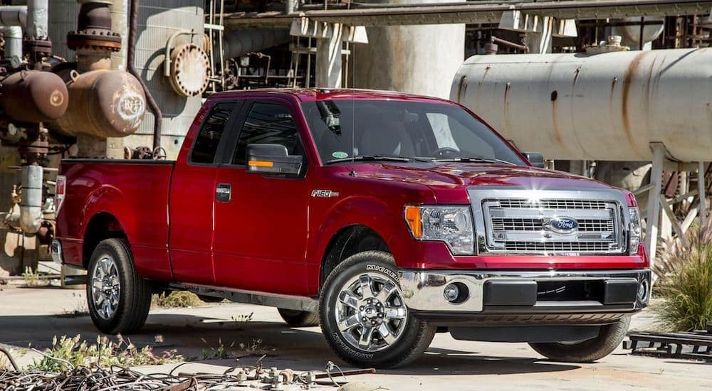 A red 2013 used Ford truck on a Indianapolis job site