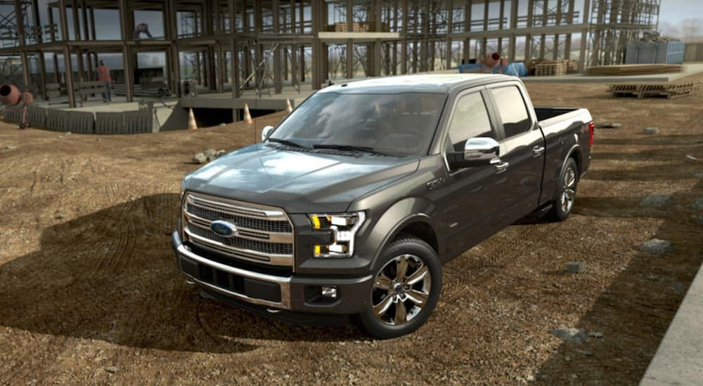 A gray 2015 Ford F-150 on a local construction site