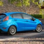 A couple is walking to their blue 2016 Ford Fiesta that they purchased from an alternative to Columbus used car dealers.