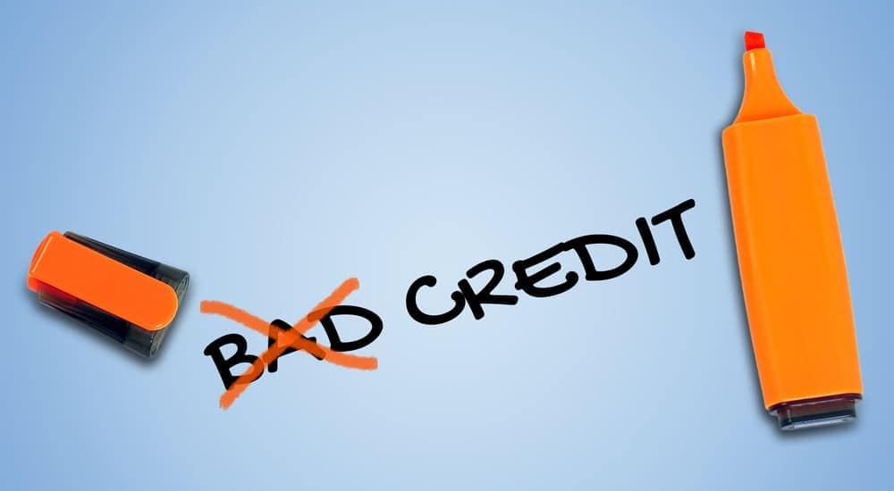 The words 'bad credit' are written next to an orange highlighter with 'bad' crossed off.