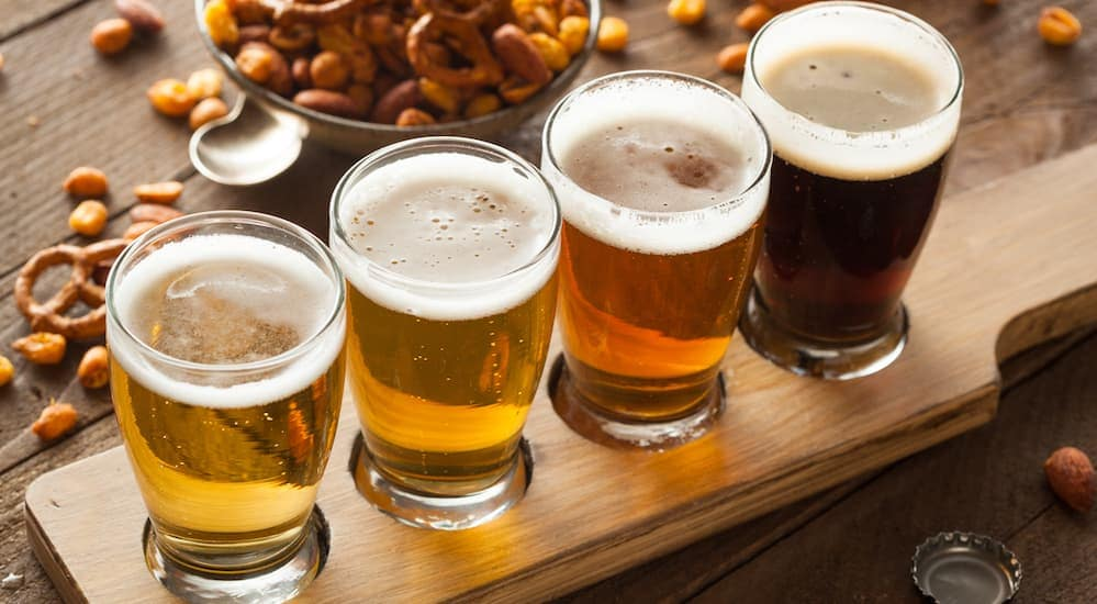Craft beer is shown on a serving board at Crafted - Food, Beer, and Music Festival.