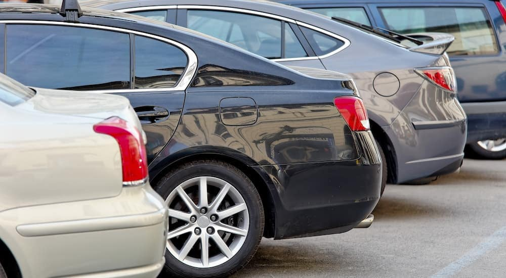 Cars are parked in a row at a dealer who specializes in Bad Credit Car Finance in Indianapolis, IN.
