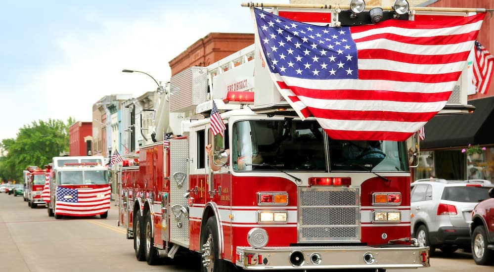 Fire trucks with the American flag are shown at the Indiana State Fair in Indianapolis in the parade.