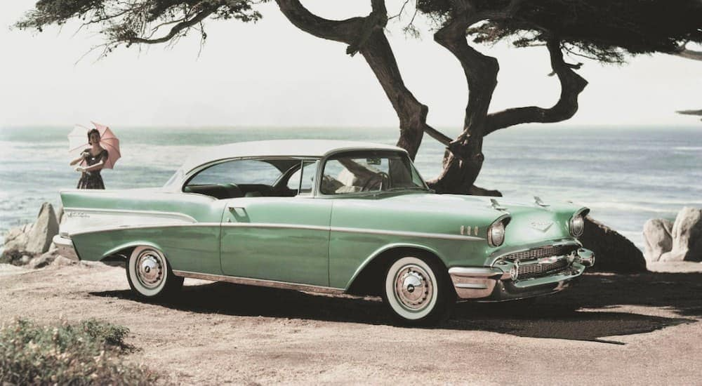 If you're looking to buy used cars in Columbus, this mint colored 1957 Chevy BelAir parked near the ocean, would be a great find.