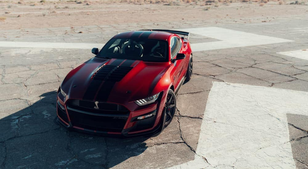 A red 2020 Mustang GT500 is on an old race track.
