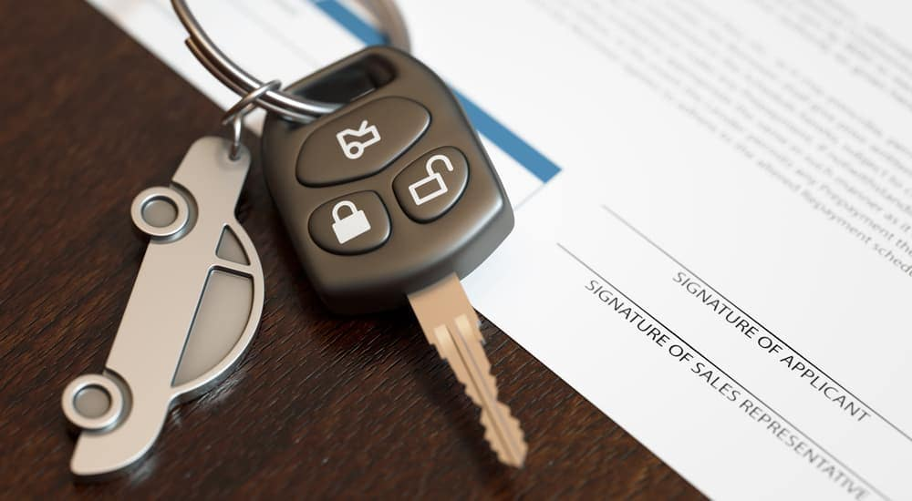 Car keys are shown next to an application for no credit car loans in Columbus.