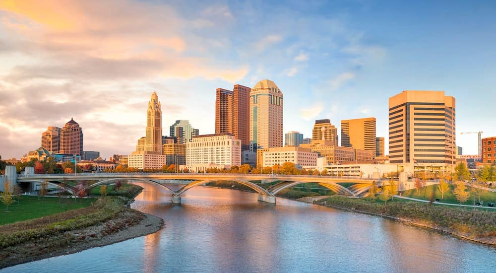 The skyline of Columbus, OH is shown.