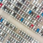 A birds eye view of cars at a dealership.