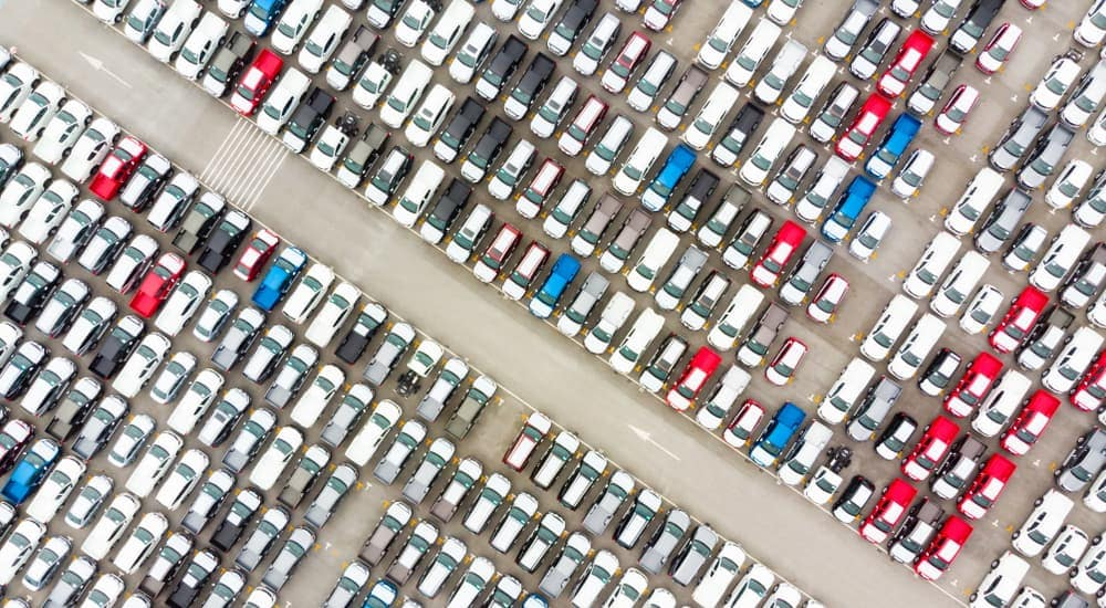 A bird's eye view of cars at a dealership.