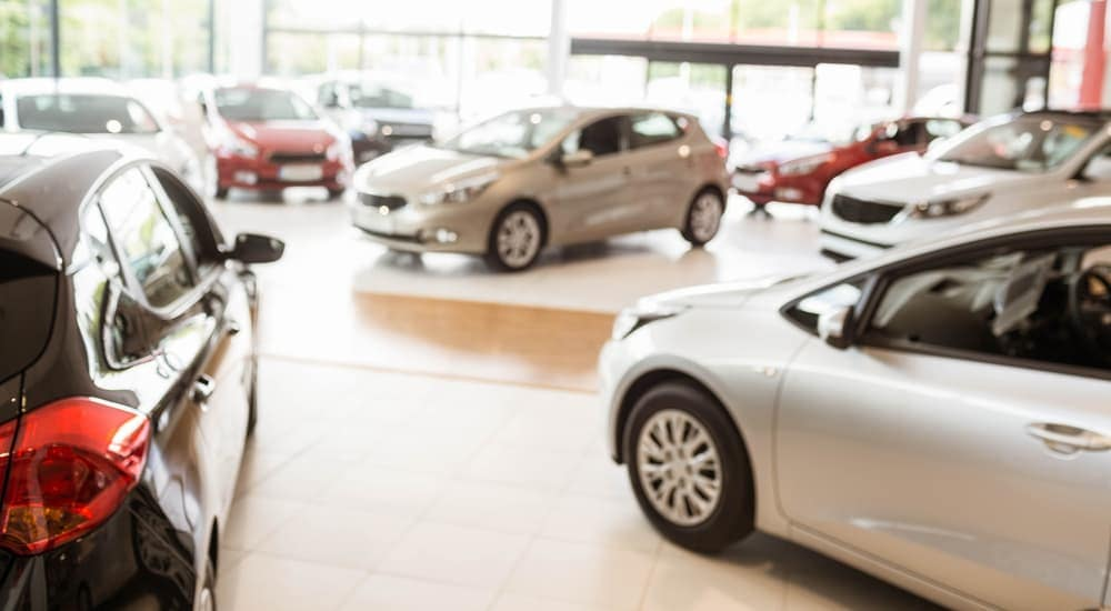 Cars are in a showroom at a local dealership in Columbus, OH.