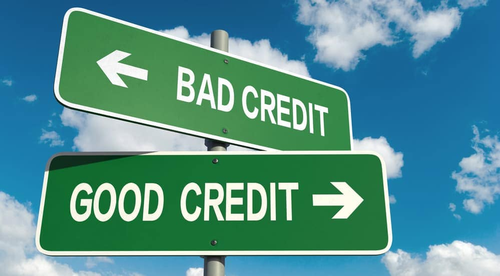 Two signs saying 'bad credit' and 'good credit', popular problems among customer looking at Buy Here Pay Here vs traditional Loan in Indianapolis, IN, is shown.