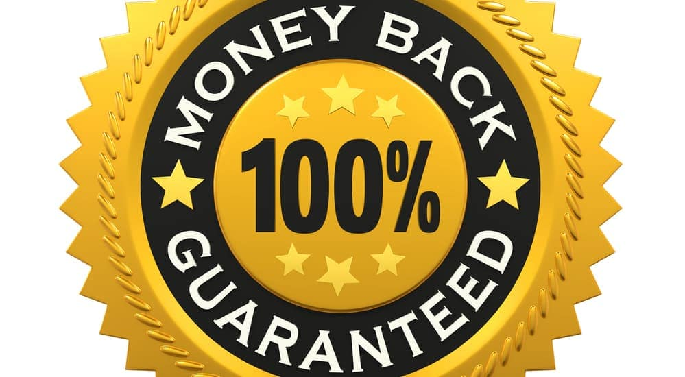 "A gold sign that says ""Money Back, Guaranteed""."