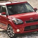 A red 2012 Kia Soul is parked on a gravel road outside Columbus, OH.