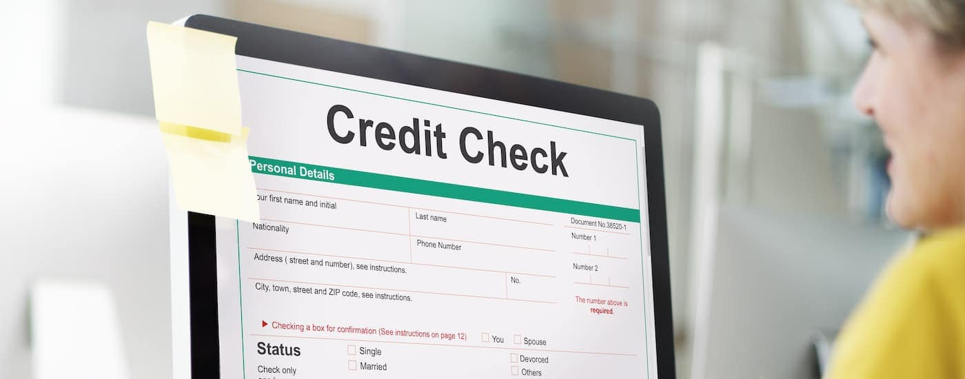 A credit check form at an online car dealership is shown on a computer screen.