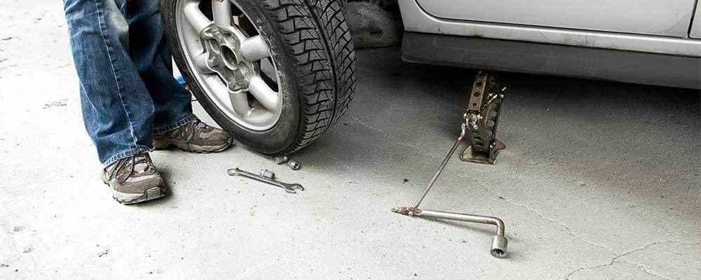 Person at Home Tire Change
