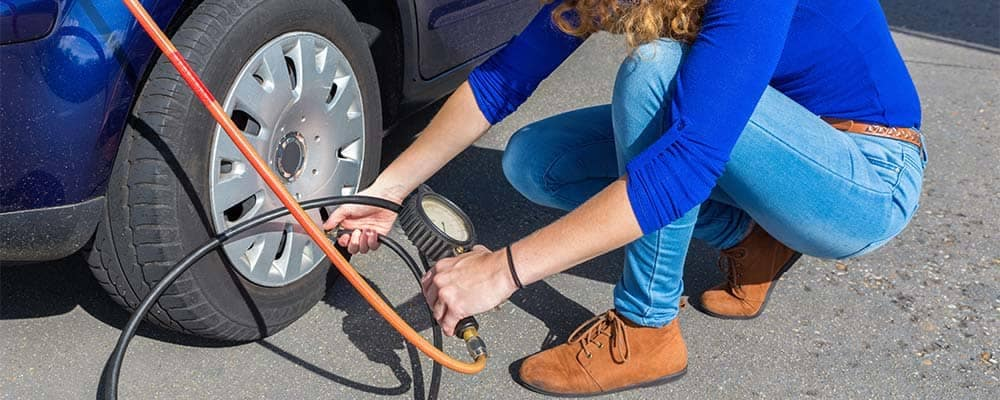 Woman inflating tire