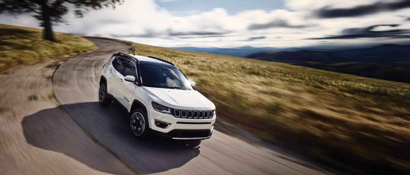 2019 Jeep Compass driving hillside