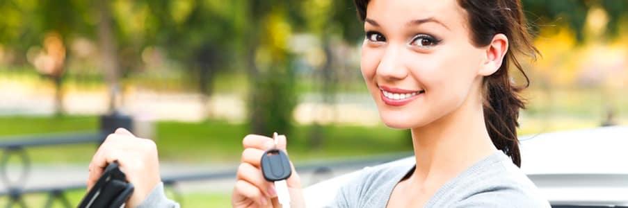 woman holing car keys