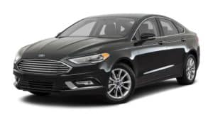 A black 2017 Ford Fusion is facing left.