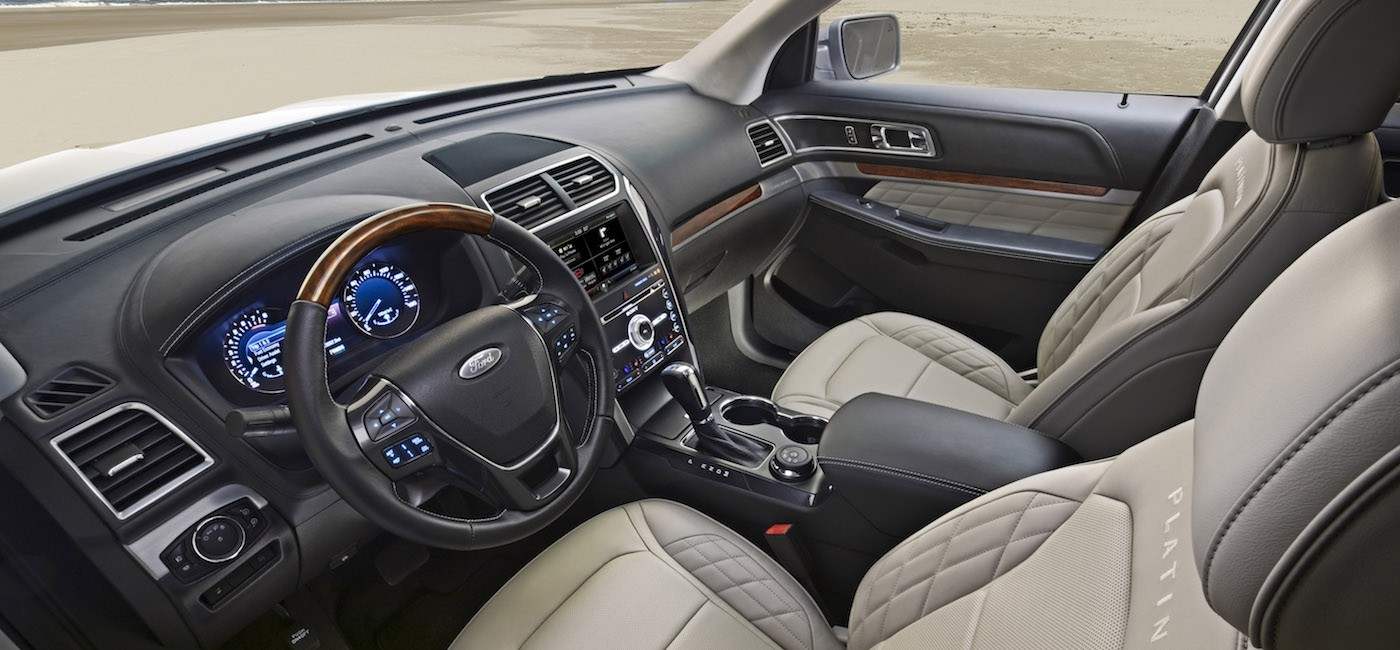 The black and white interior of a 2017 Ford Explorer is shown.