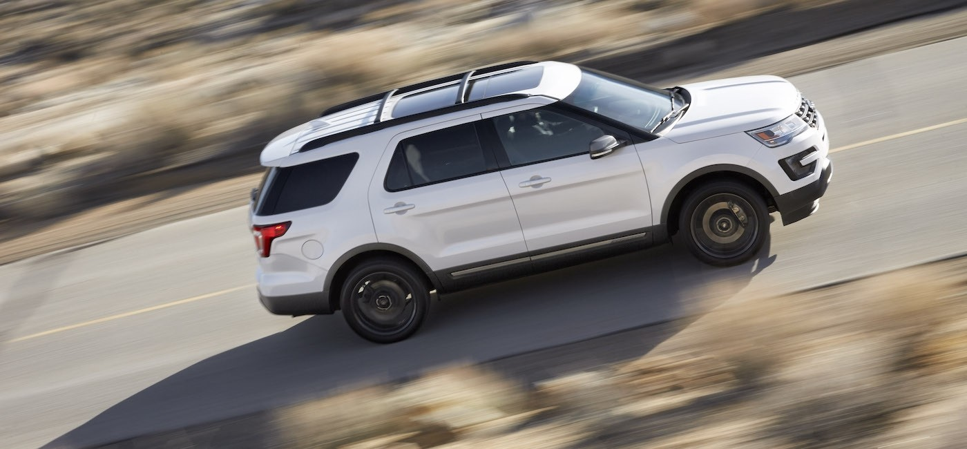 A white 2017 Ford Explorer is shown from an above angle on a blurred road near Albany, NY.