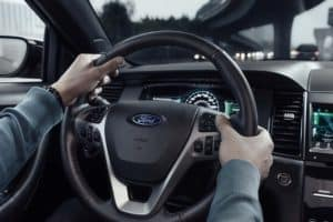 man holding steering wheel in new 2019 Ford Taurus SHO