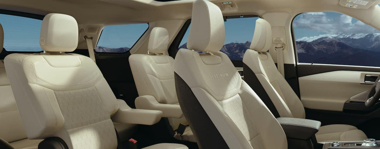 The light tan and black front and rear interior of a 2020 Ford Explorer.