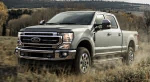 A silver 2020 Ford Super Duty is facing left.
