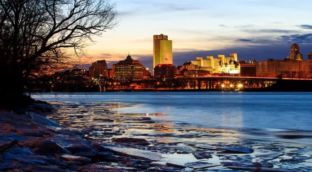 The skyline of Albany, NY during dusk.