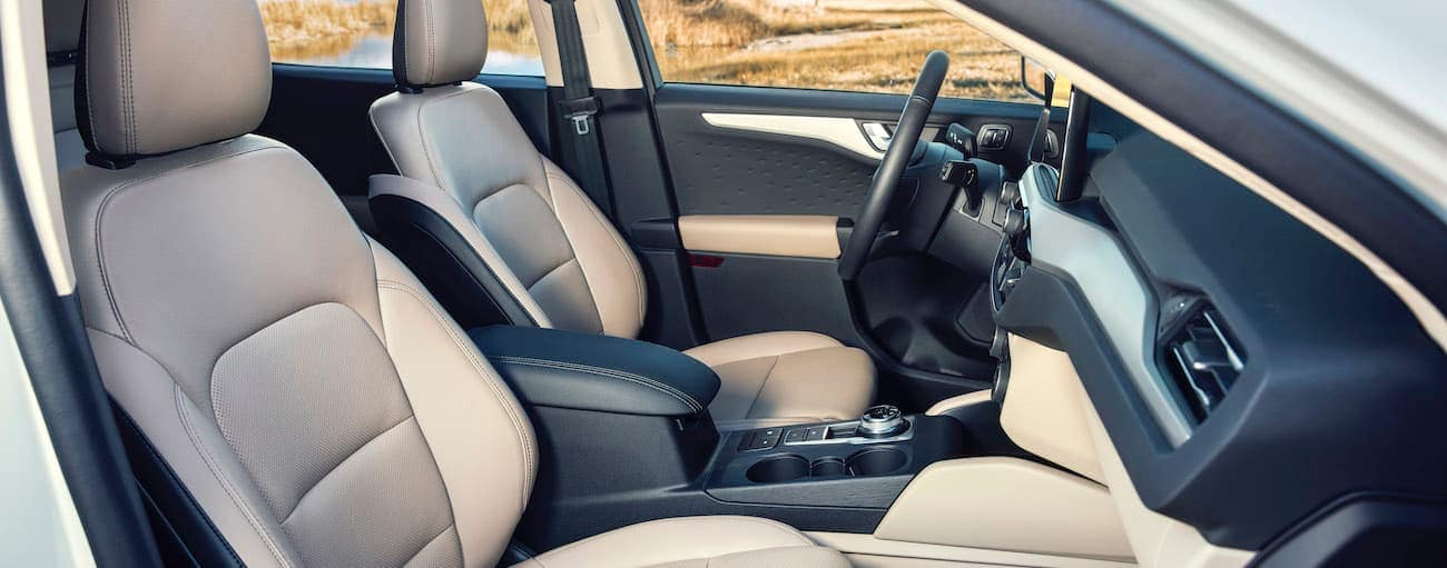 The white and black interior of a 2020 Ford Escape is shown.