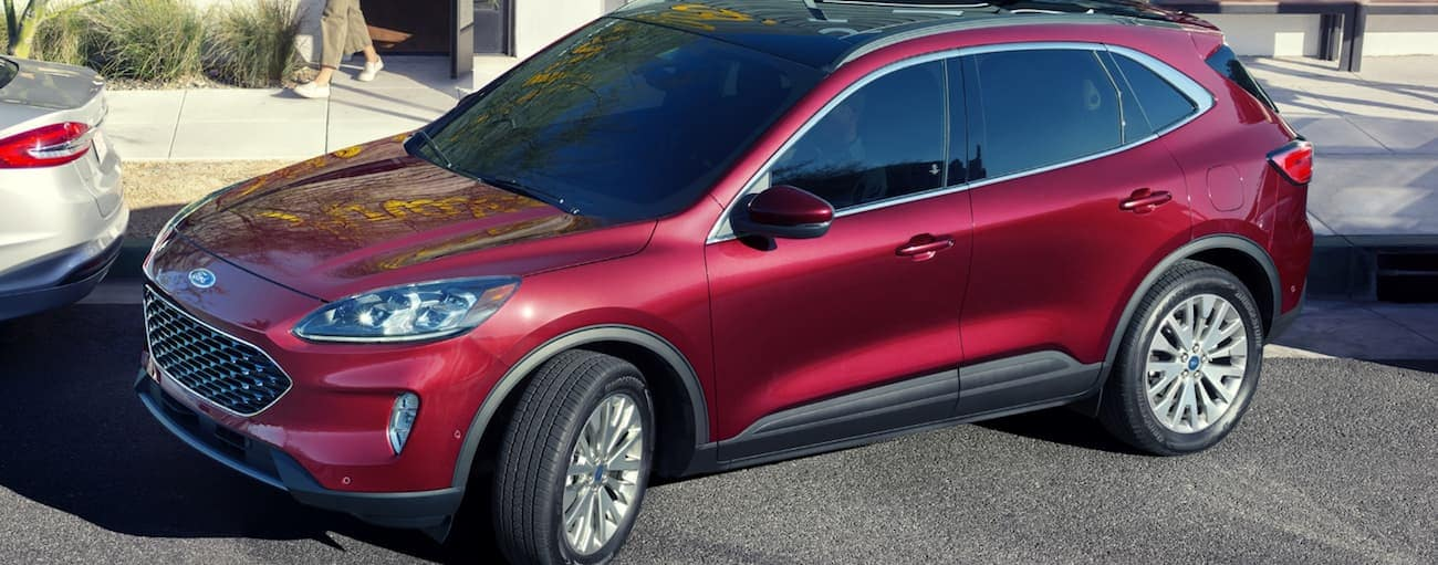 A red 2020 Ford Escape is parallel parking in front of a restaurant near Albany, NY.